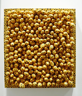 "Yayoi Kusama ""Yellow Dots A"" painting at the MCA EXPO."