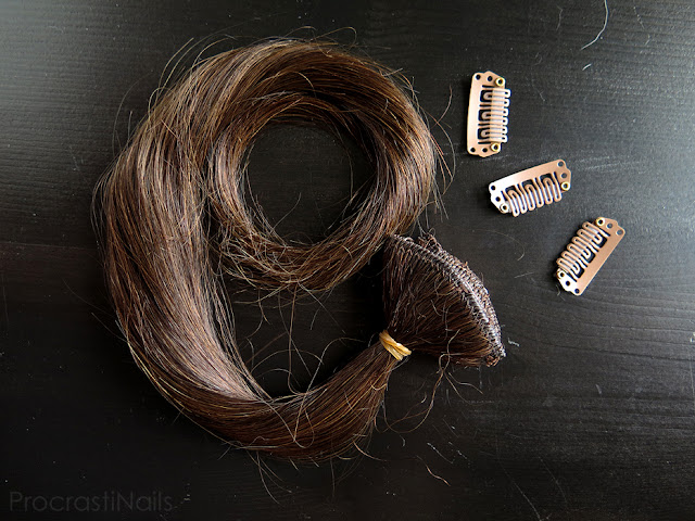 Testing the colour of Irresistible Me Royal Remy Medium Brown Clip-in Hair Extensions