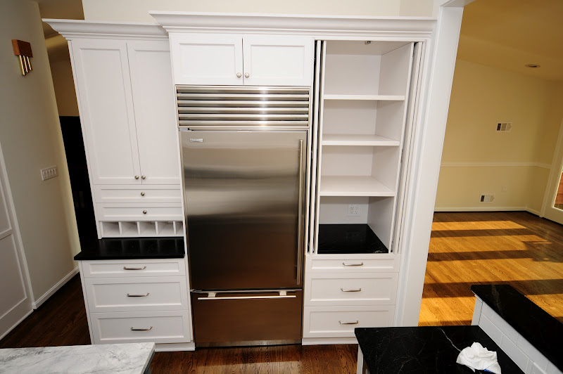 Retractable pantry door cabinet. Perfect spot for the small appliances  title=