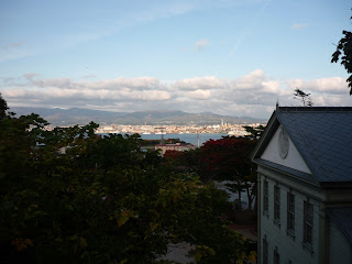 Looking down to the ocean from Motomachi with part of a western house in the frame