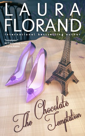 A pair of glass slippers and a miniature of the Eiffel Tower on top of a table.