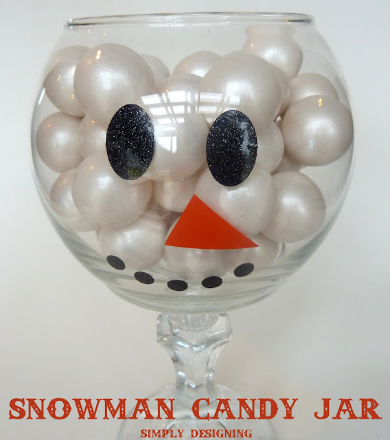 Snowman Candy Jar - so simple to make and a really cute addition to your #winter decor!  #snowman #snowmancrafts #christmas #candyjars