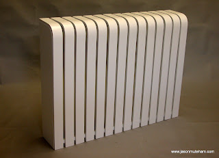 A white designer radiator cover