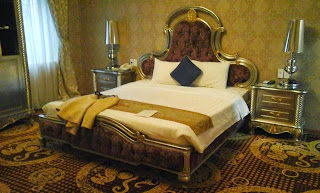Holiday in Vietnam: King size bed fit for a queen.