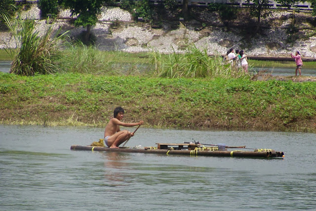 Guilin fisher man on raft
