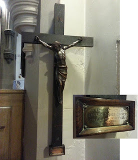 Photo of a commemorative crucifix with inset enlargement of detail on brass plaque - see caption