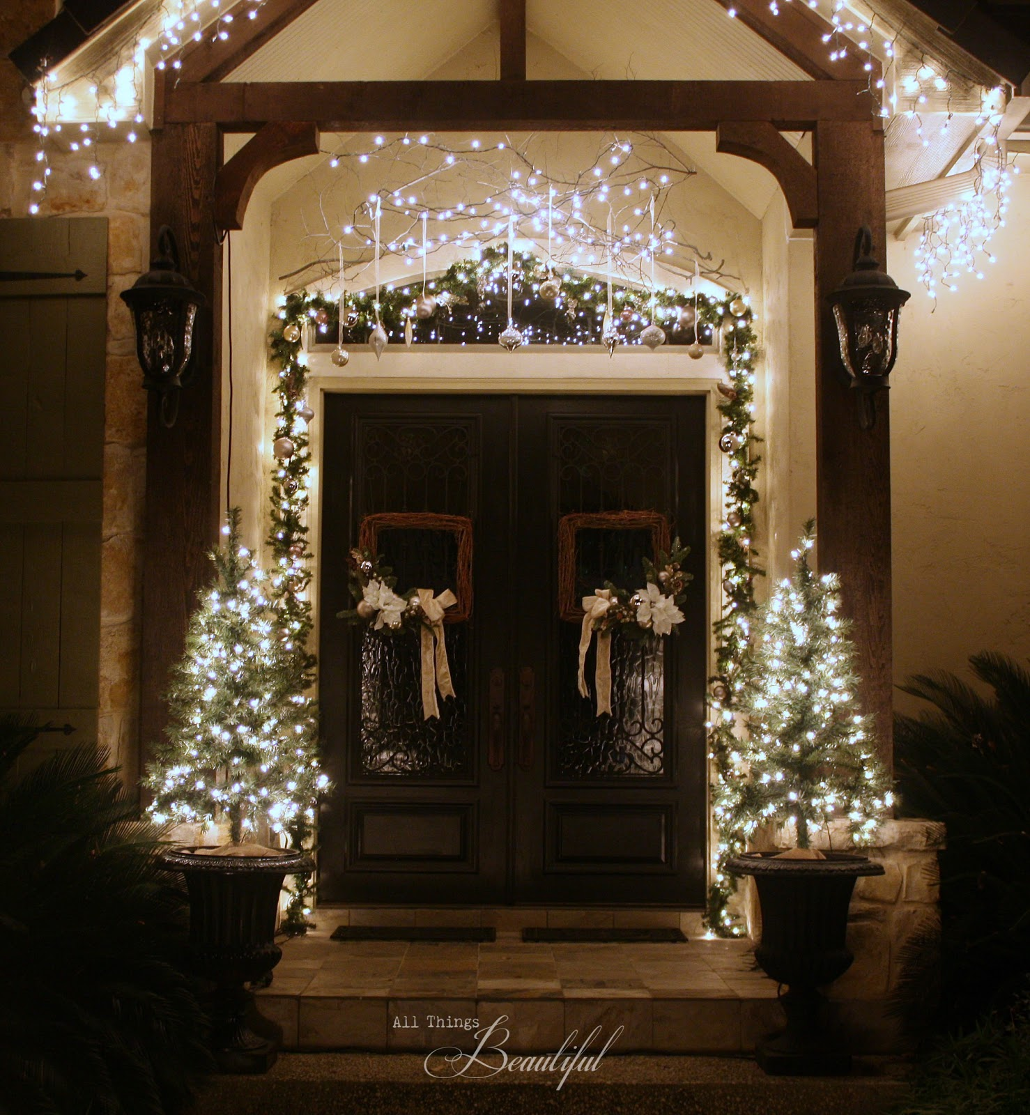 All things beautiful christmas porch garland for Front porch lighting ideas