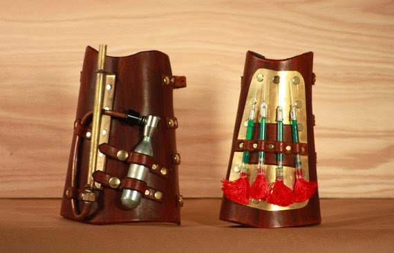 https://www.etsy.com/listing/169324684/steampunk-pneumatic-dartgun-bracers?ref=shop_home_active_10