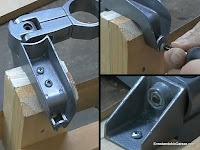 Soporte metálico atornillado a la pieza de madera. www.enredandonogaraxe.com