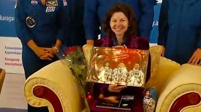 Cadi Coleman receives presents from the Mayor of Karaganda. NASA 2011.