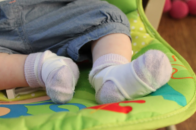 close up photo of sock ons on baby's foot