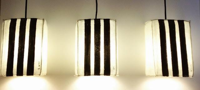 cette lampe est faite à la main avec une bonbonne d'eau comme support