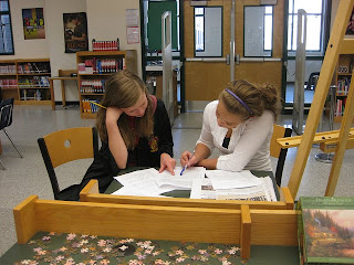 A student edits another student's paper
