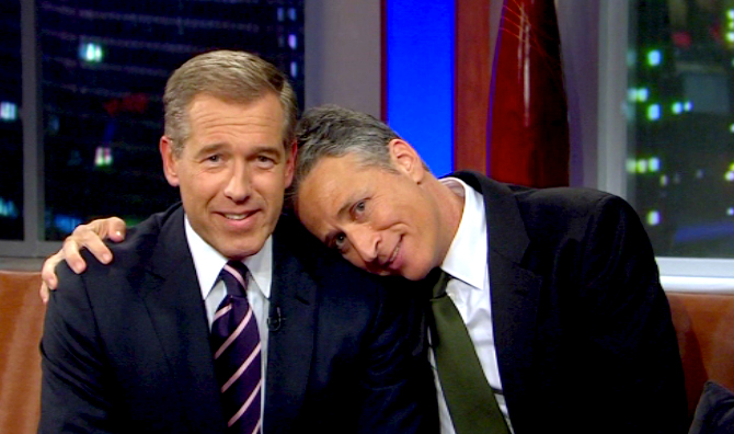 Brian Williams and John Stewart sharing a moment