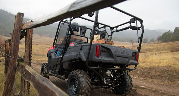 2014 Honda Pioneer 700-4 rear independent suspension and roll cage.