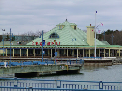 On the banks of the Credit River, green roofed Snug Harbour at the Credit VIllage Marina.