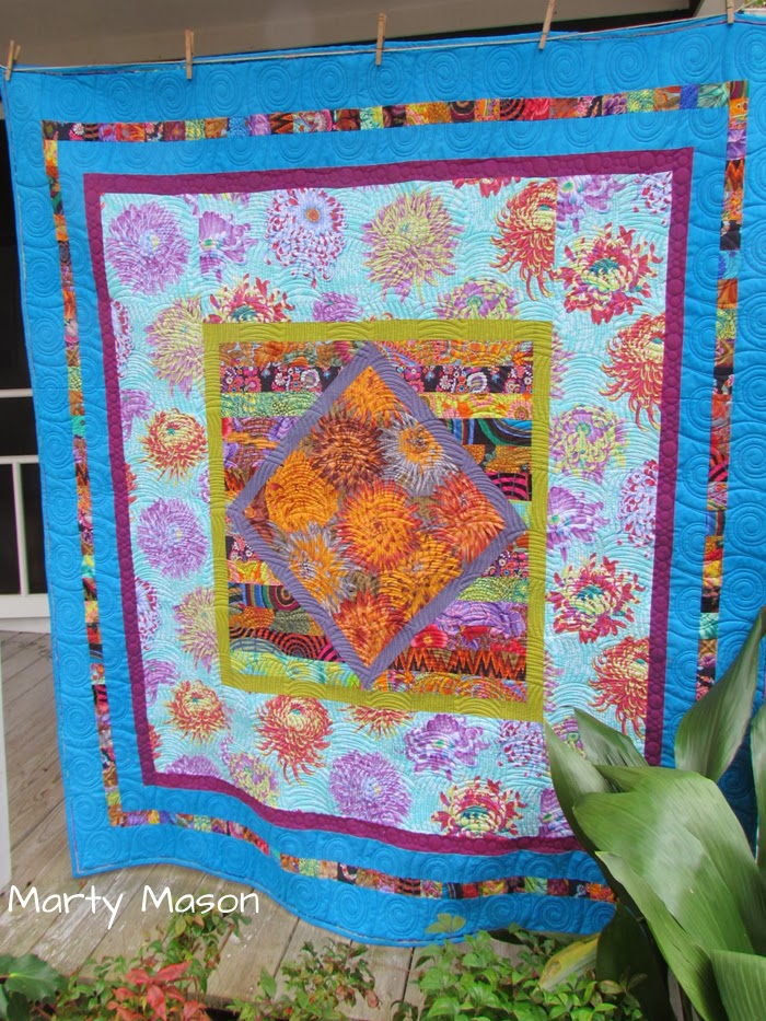 I call this one my Dahlia Quilt....marty mason