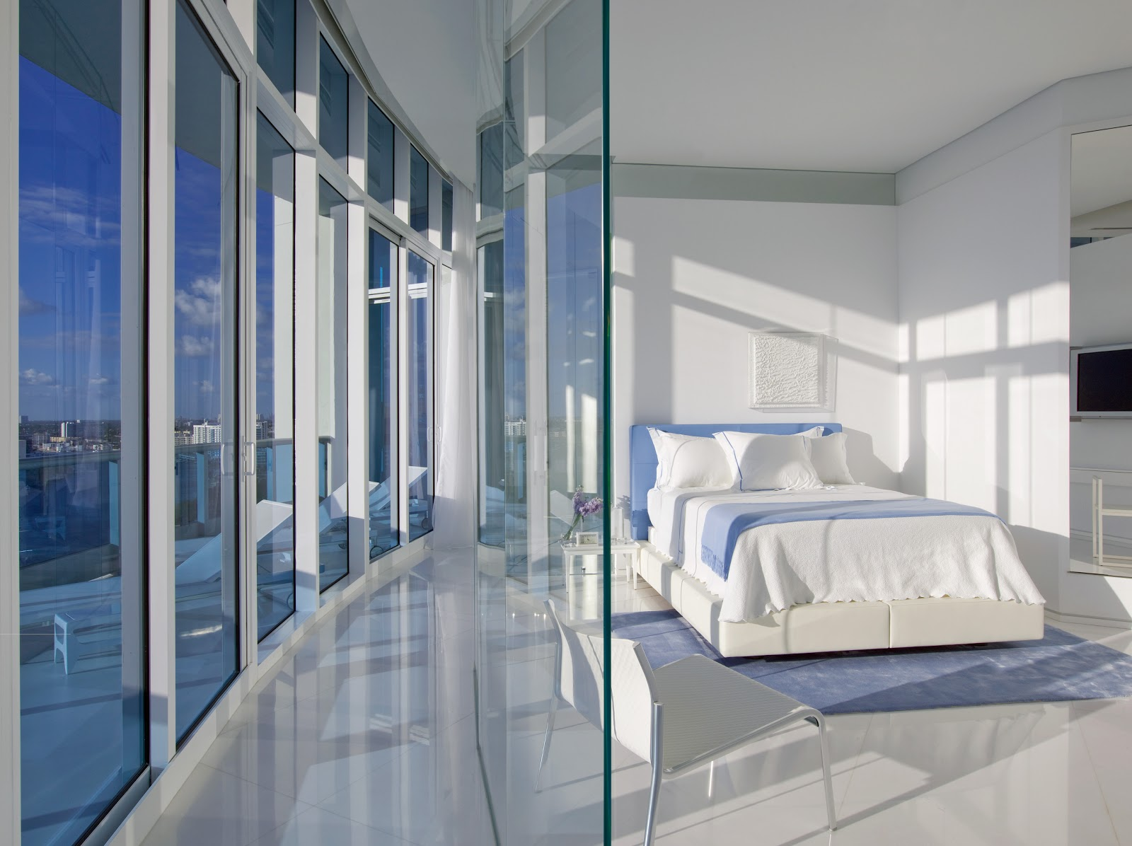 This bedroom sits on a corridor of glass keeping it open to the views glass goes opaque at the