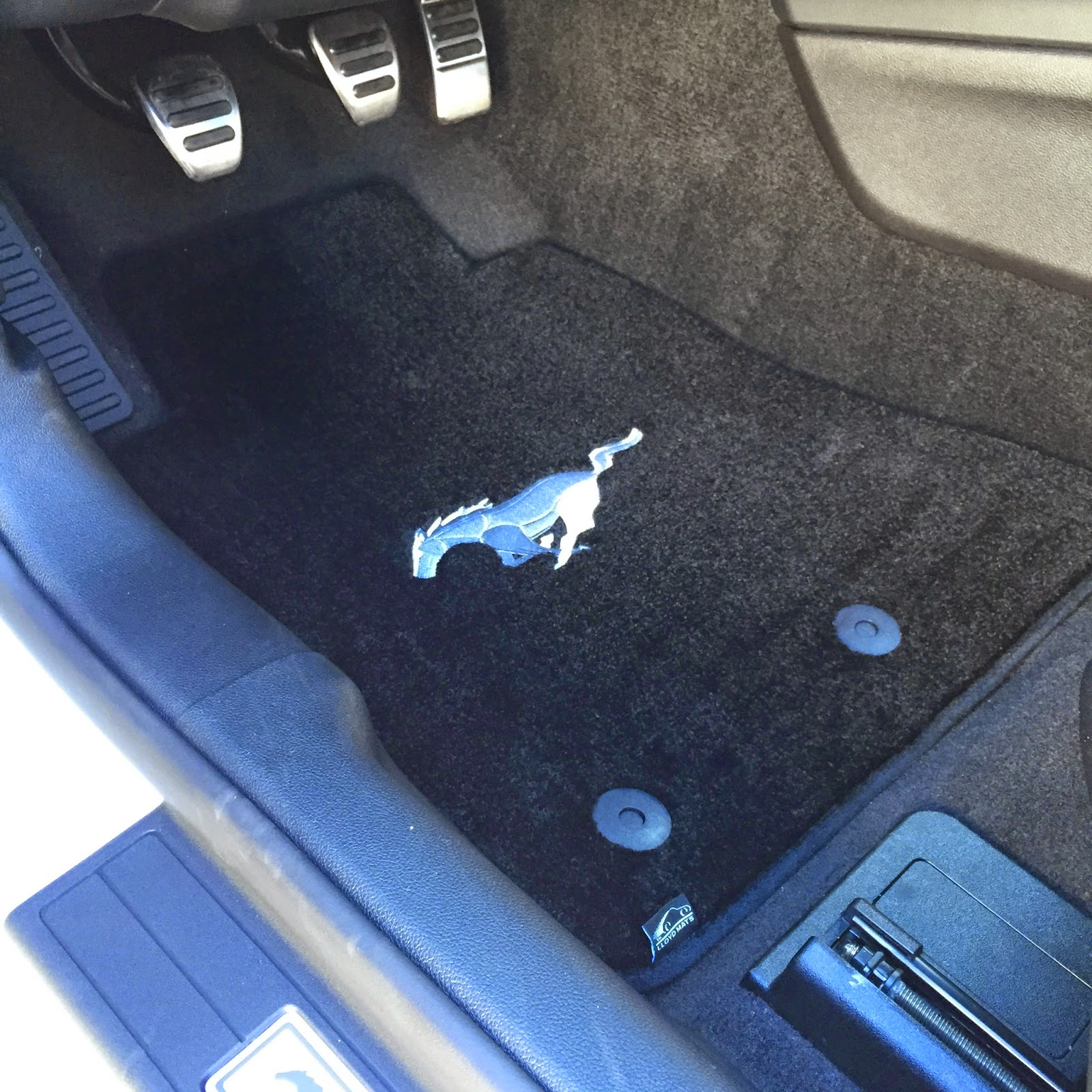 Custom fit lloyd floor mats not only add style to the 2015 ford mustang but protect the interior as well the mats are available in a variety of carpet