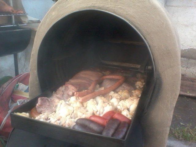 Horno de barro con ruedas horno de barro port til dieciochero - Cocinar en horno de lena ...