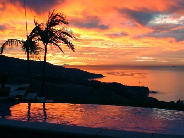 Photo of romantic sunset as seen from the pool