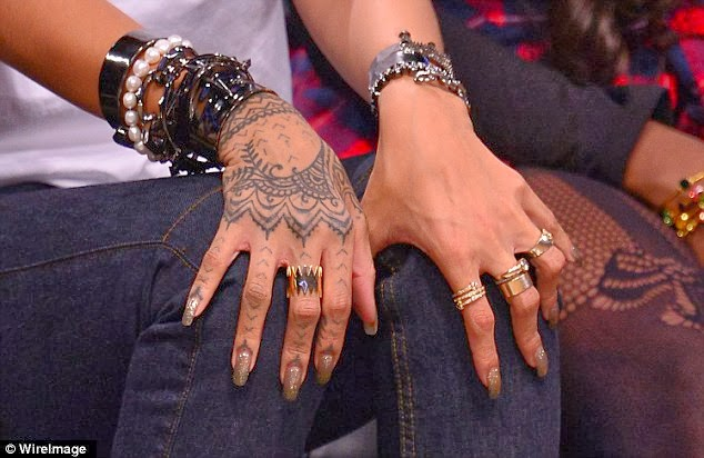 celebrity buzz check out rihanna s new tattoo. Black Bedroom Furniture Sets. Home Design Ideas