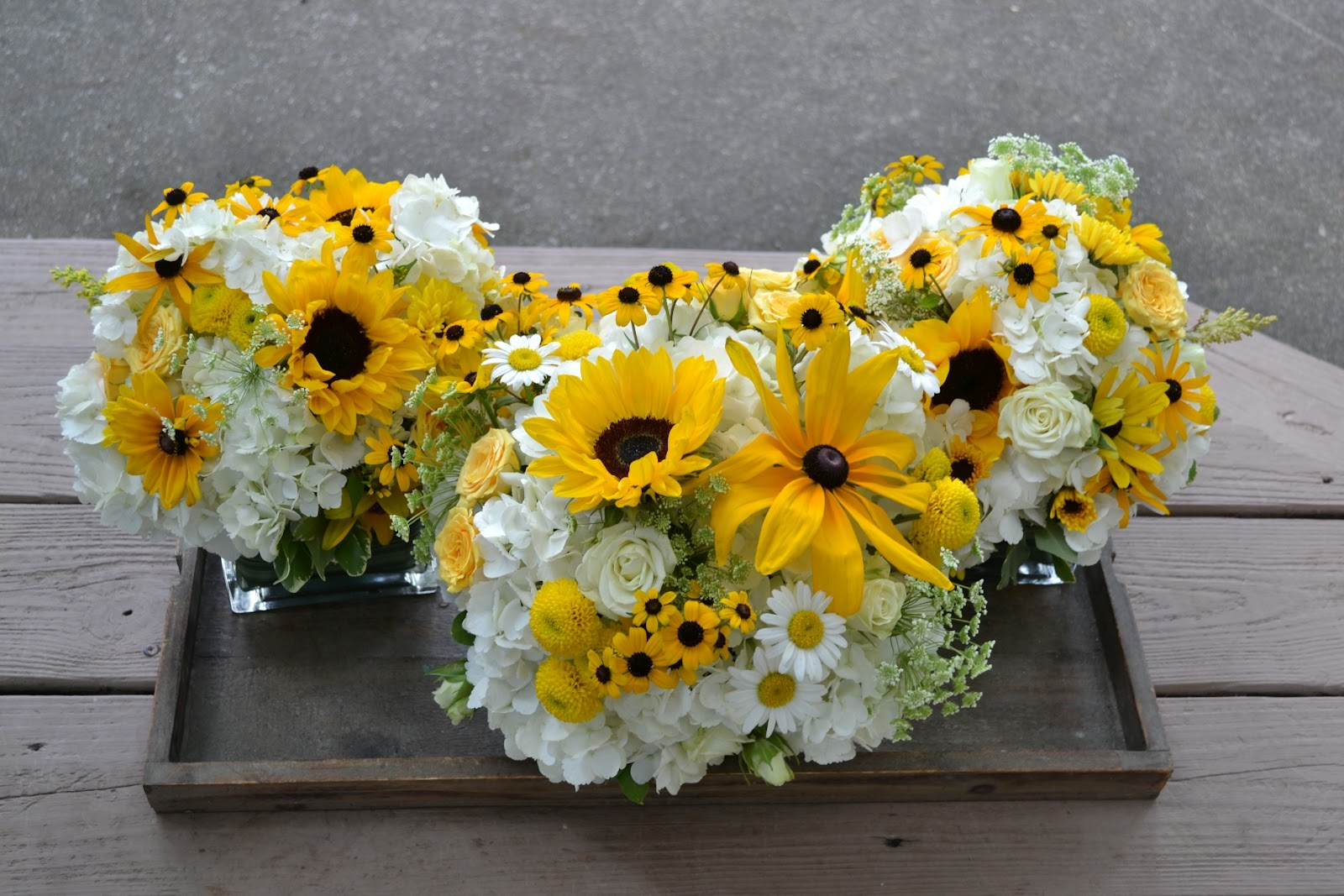 Wedding flowers from springwell sunflowers and black eyed susans more flowers for the gorgeous wedding cake created by jennys cupcakery izmirmasajfo