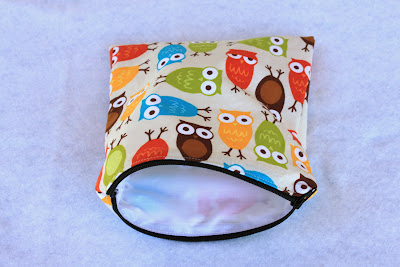 owl themed re-useable sandwich bag laying on a table with the zipper open