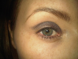 applying grey colour to eyelids