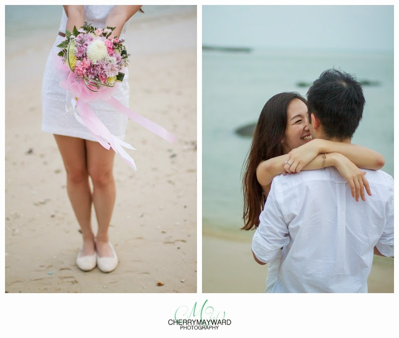 happy couple on the beach, flower bouquet, soft pink flower beach engagement, koh samui proposal