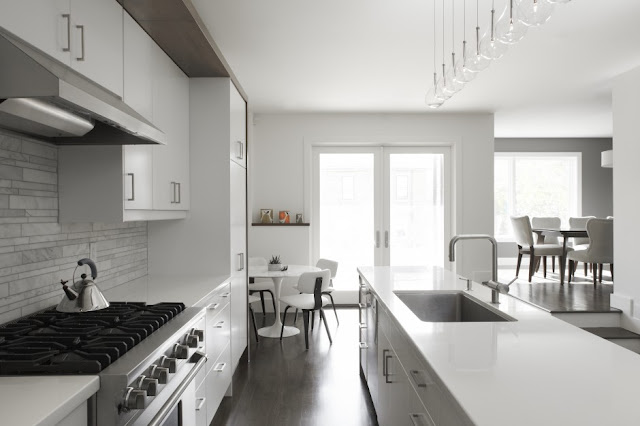 Picture of the minimalist kitchen with white and gray furniture