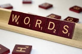 "Photo of Scrabble game tile rack with tiles spelling out the word ""WORDS"""