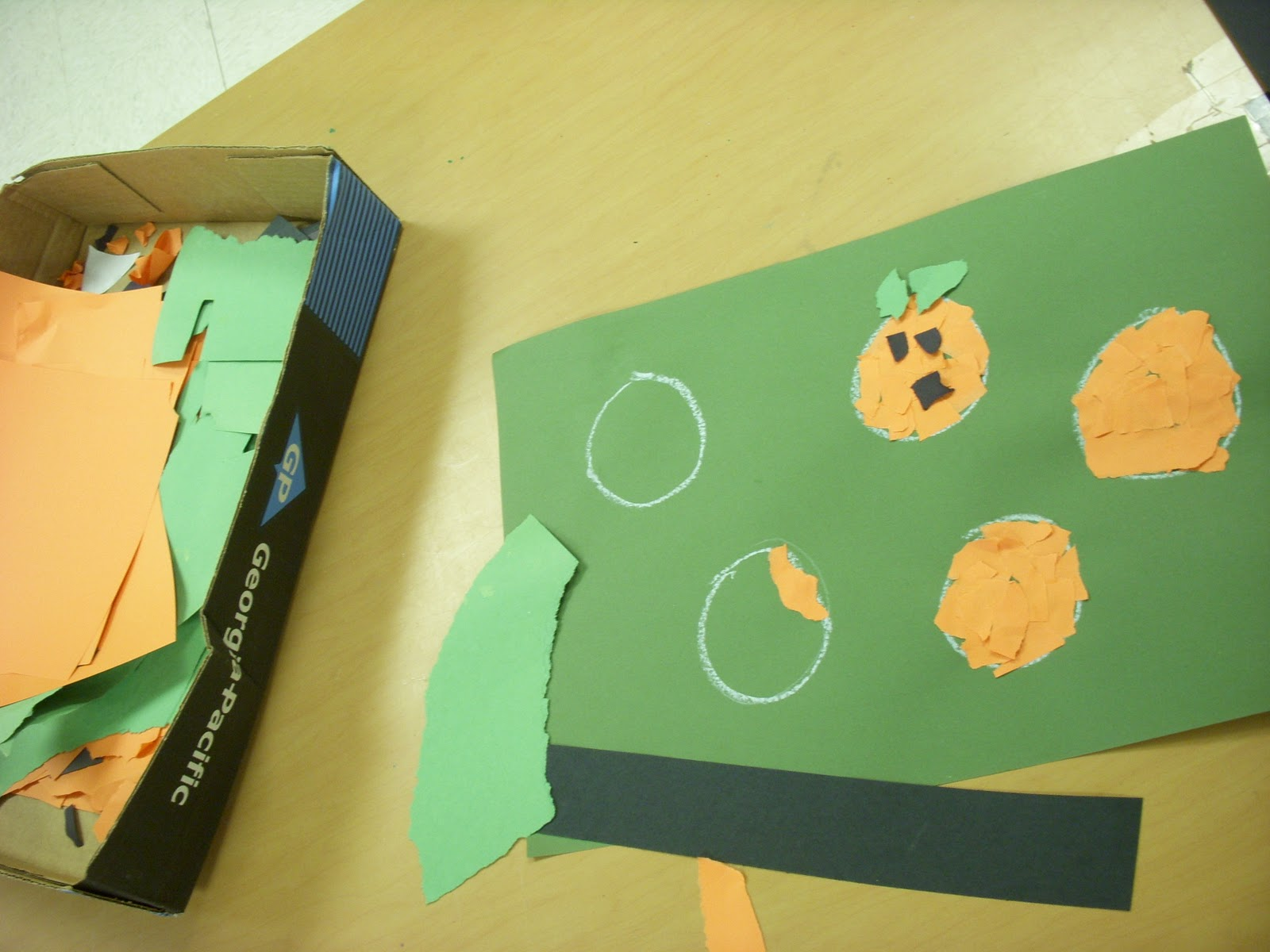 Tear fall colored construction paper into small pieces and glue - Students Were Directed To Tear Orange Construction Paper Into Small Pieces And Fill In Their Pumpkins We Talked About Using Baby Dots Of Glue And How