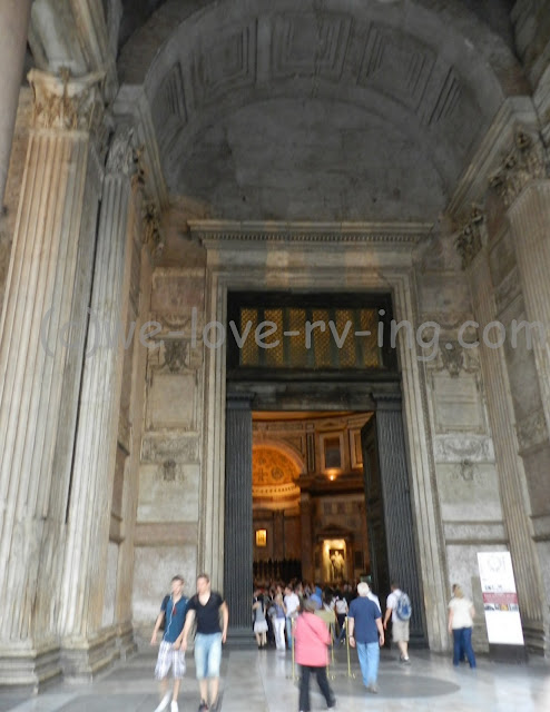 The open doors of the Pantheon welcome us inside