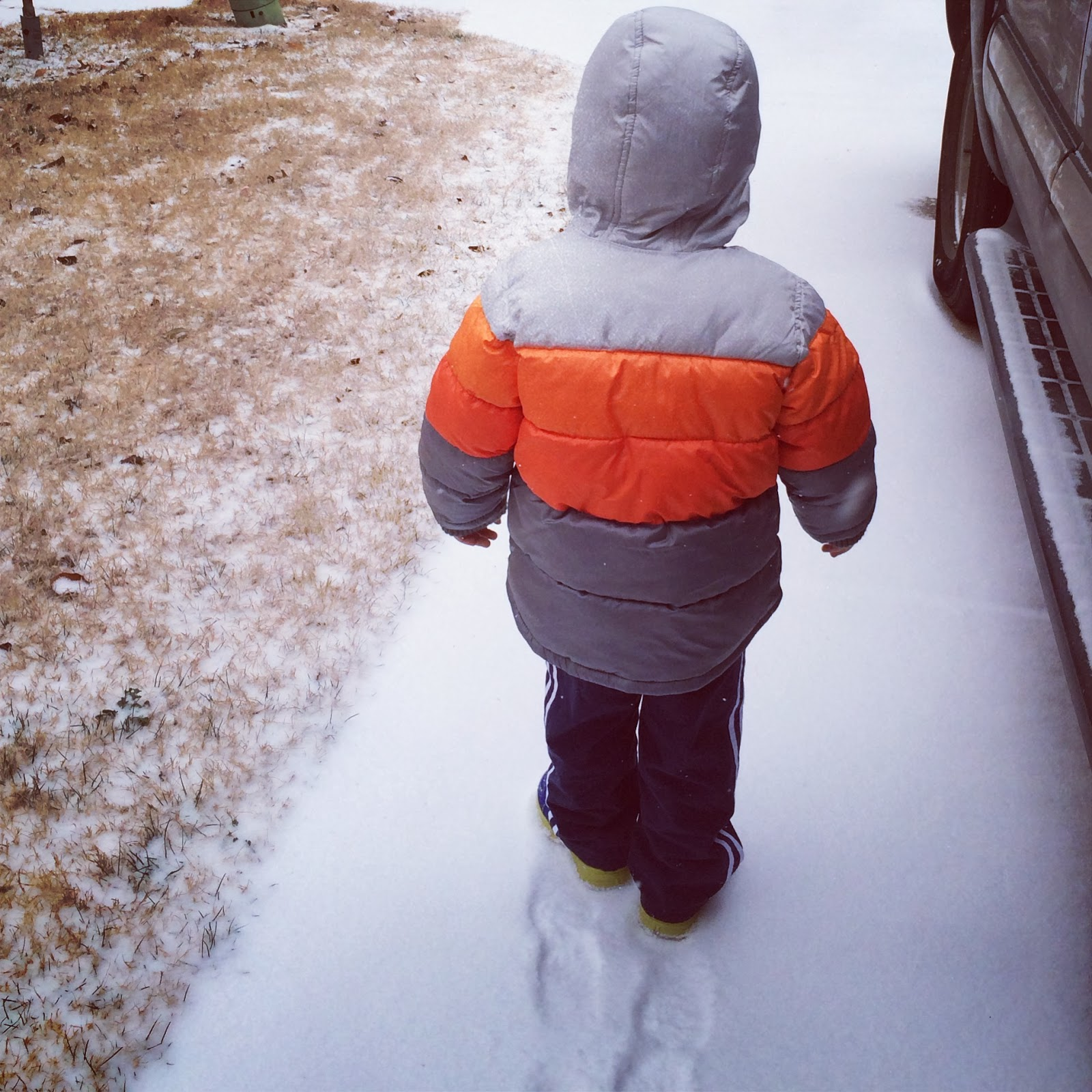 toddler footprints in the snow