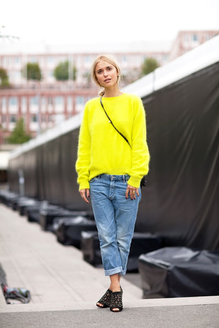 boyfriend jeans Paired with a bright neon furry sweater