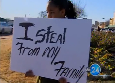 VIDEO - THIEVING GIRL, 13 FORCEDO TO HOLD :  'i steal from my family' SIGN AT BUSY INTERSECTION