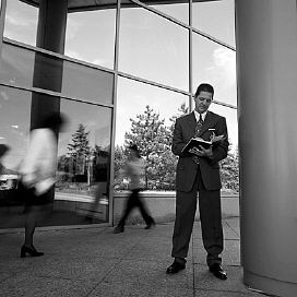 man standing outside office building