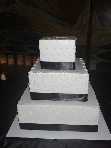Three Tier White Square Wedding Cake With Satin Ribbon