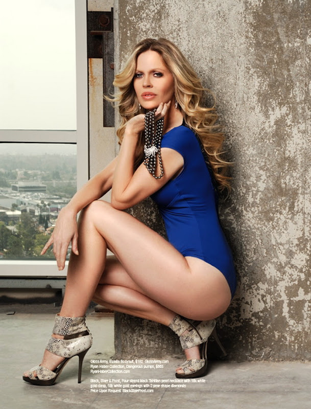 Kristin Bauer in a blue corset and high heels