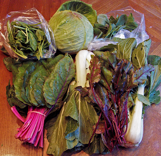 Six Kinds of Greens in a Big Stack on the Table