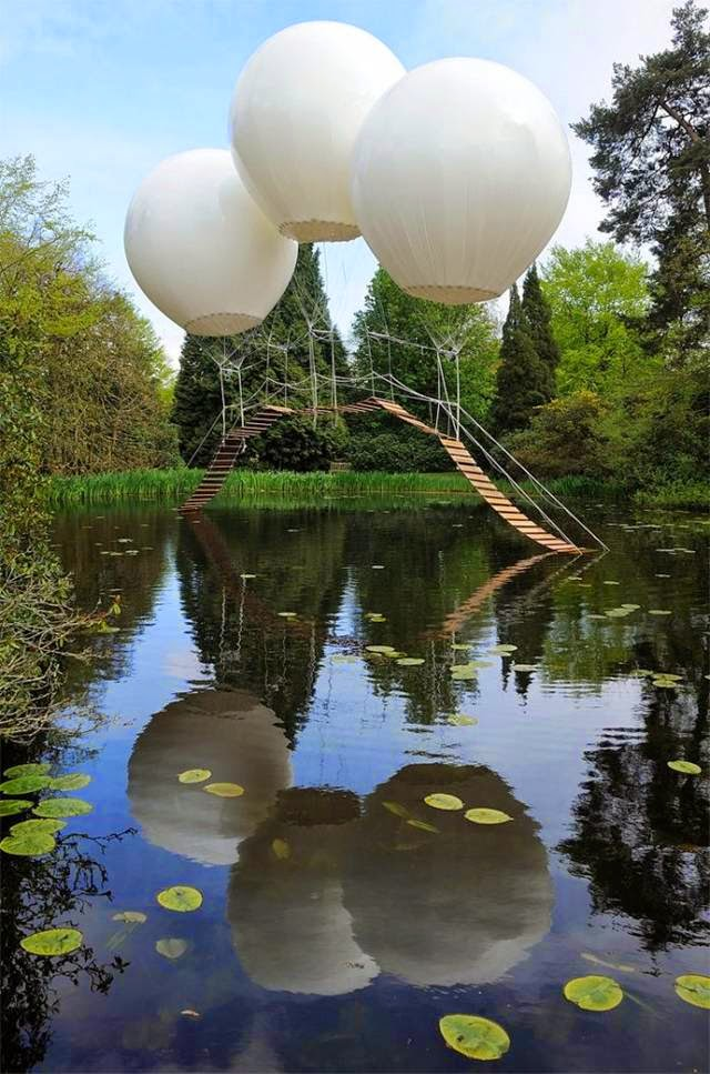 "The name means ""Monkey Bridge,"" and this was created for a biennial celebration by French artist Olivier Grossetête (who translates to ""big head""). The bridge is suspended by helium balloons here. It was ""theoretically"" strong enough to hold a person, but the park didn't take the chance."