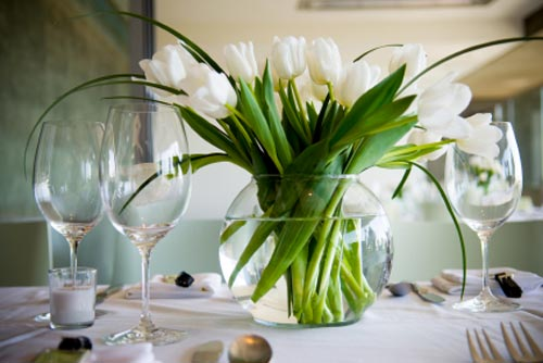 A footed bowl of shells is hard to beat White tulips in a goldfish bowl