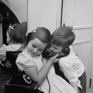 holmes martha brother and sister sharing the telephone to talk to santa claus Sharing is Caring......