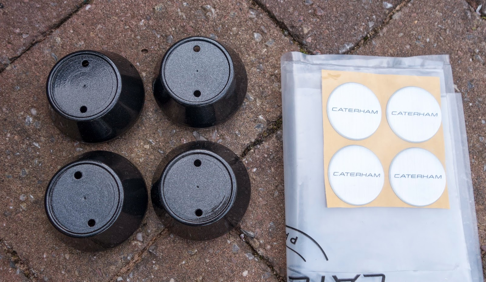 Caterham wheel centre caps with centre cap stickers ready for application