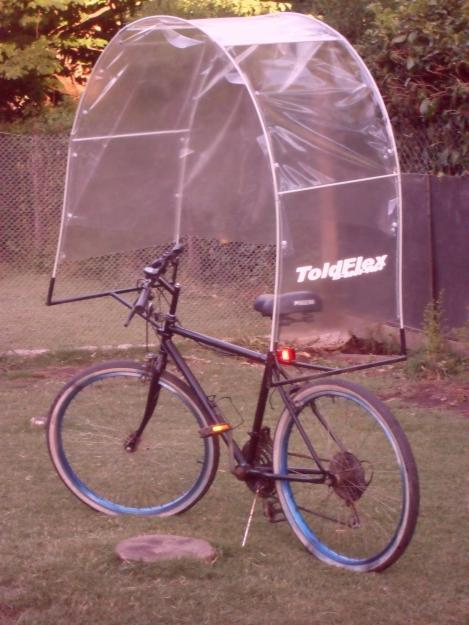 Sabados en bicicleta lluvia viento o frio pero en la ruta for Toldos para lluvia