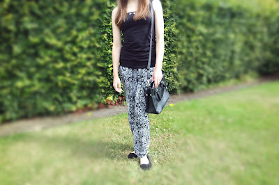 Highstreet Clothing, Patterned Monochrome Trousers, Black Vest Top, Statement Necklace, Newlook, Primark Shoes, Handbag, Background - Park with bushes and trees. Fashion Blog, photo belongs to Katie Lou do not use without permission