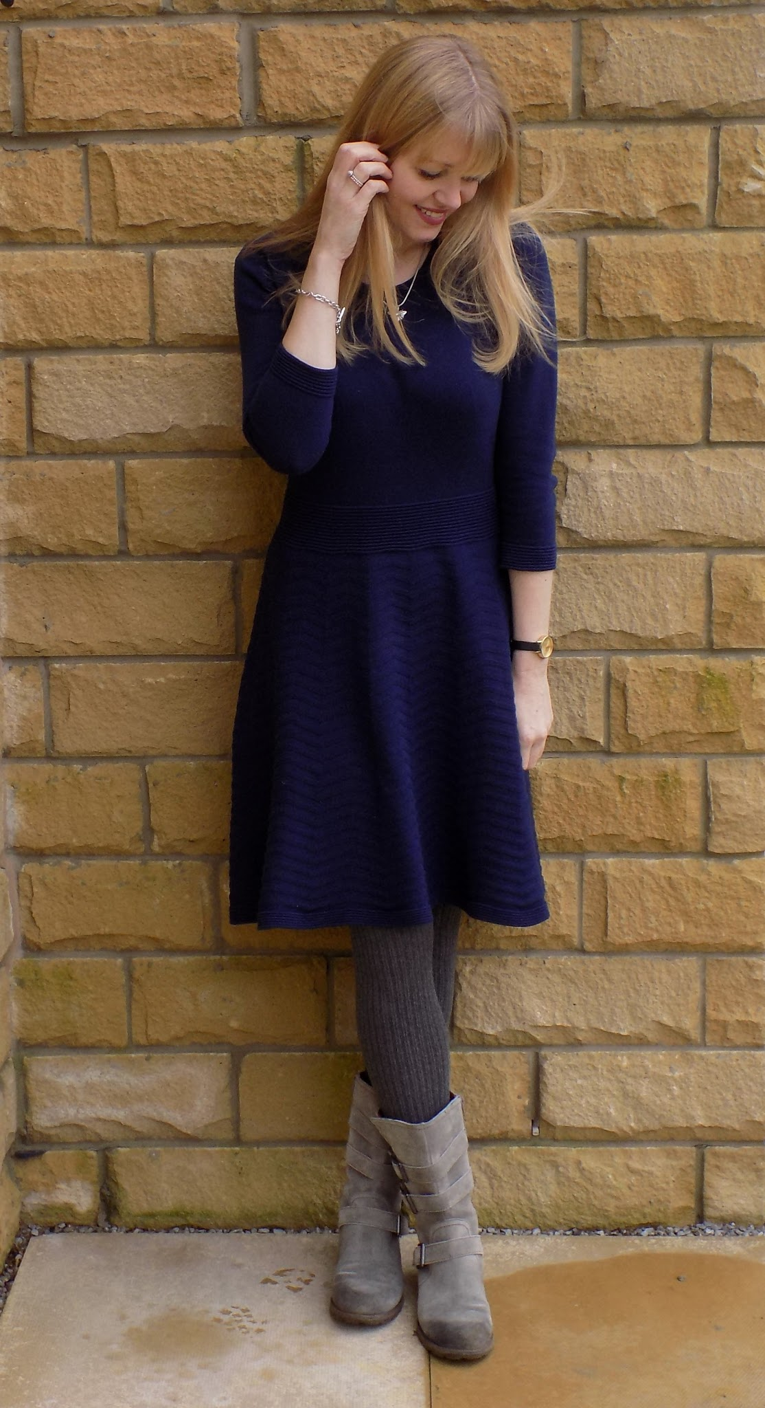 navy knitted skater dress and grey biker boots