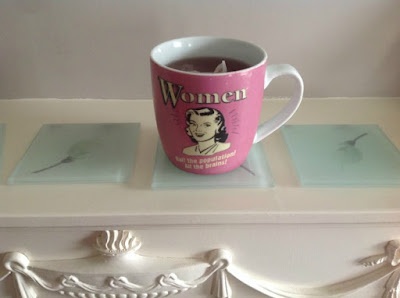 cup of fruit tea on mantelpiece