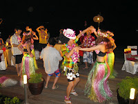 Hawaiian dancers having fun with the guests